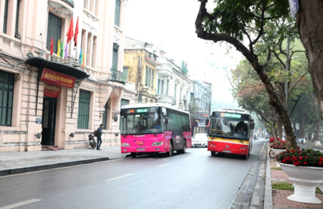 The bus with different exterior moving around Hanoi.