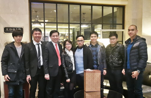 HCYU Secretary Nguyen Long Hai takes photo with OV students