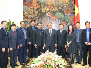 Deputy Prime Minister Nguyen Xuan Phuc meets Lao People's Revolutionary Youth Union delegation (Photo: VNA)